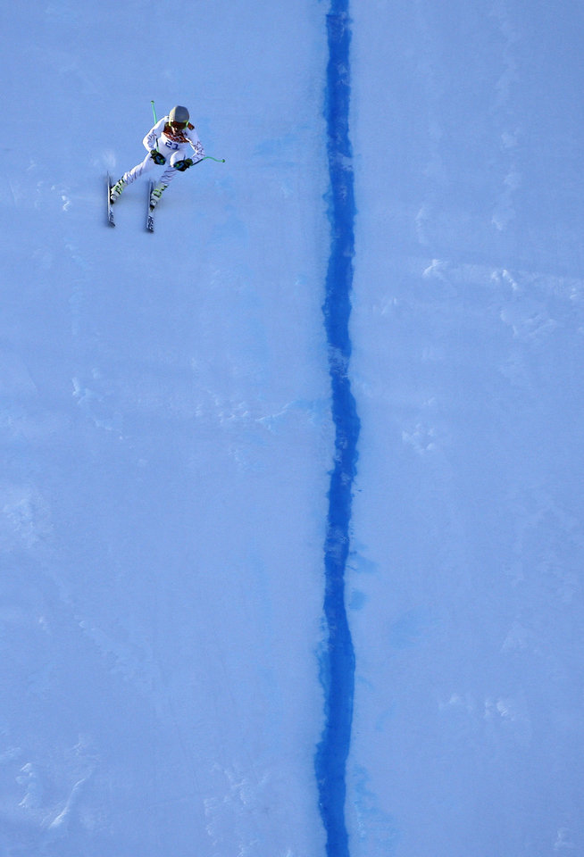 Photo - United States' Ted Ligety makes the final descent into the finish area to complete men's downhill combined training at the Sochi 2014 Winter Olympics, Thursday, Feb. 13, 2014, in Krasnaya Polyana, Russia. (AP Photo/Christophe Ena)