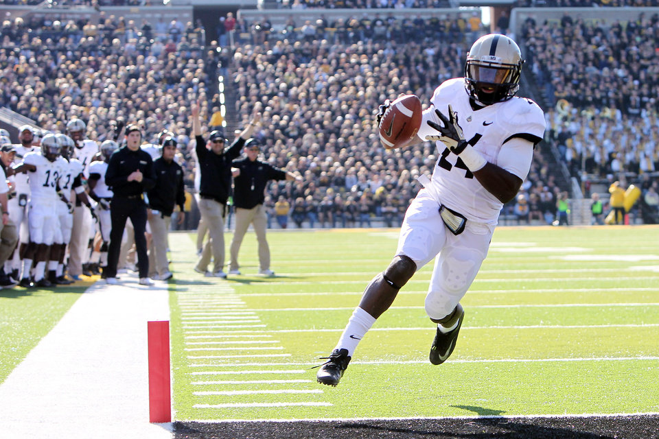 Photo -   Purdue running back Akeem Shavers (24) crosses the goal line for Purdue's first touchdown in the first half of during the first half of an NCAA college football game against Iowa, Saturday, Nov. 10, 2012, in Iowa City, Iowa. Purdue won 27-24. (AP Photo/The Gazette, Liz Martin)