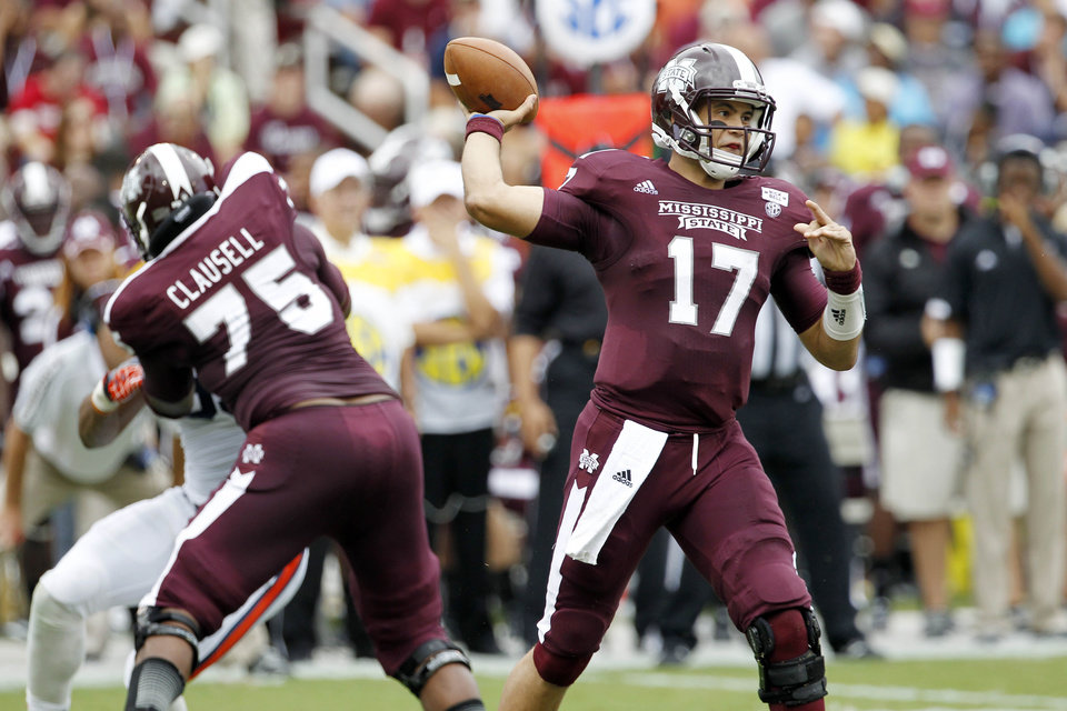 Photo -   Mississippi State quarterback Tyler Russell (17) throws a short pass as teammate offensive linesman Blaine Clausell (75) blocks in the first quarter of their NCAA college football game in Starkville, Miss., Saturday, Sept. 8, 2012. (AP Photo/Rogelio V. Solis)