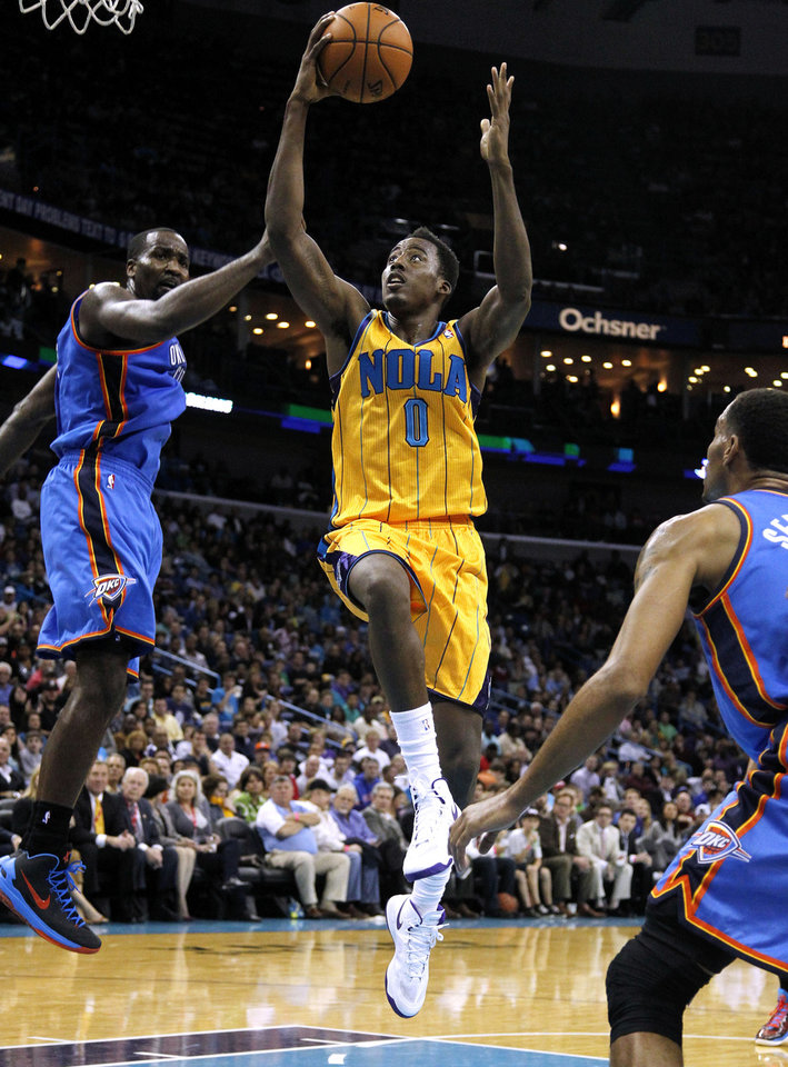 New Orleans Al-Farouq Aminu (0) goes to the basket past Oklahoma City's Serge Ibaka, left, during the second half of an NBA basketball game in New Orleans, Friday, Nov. 16, 2012. The Thunder won 110-95. (AP Photo/Jonathan Bachman) ORG XMIT: LAJB116