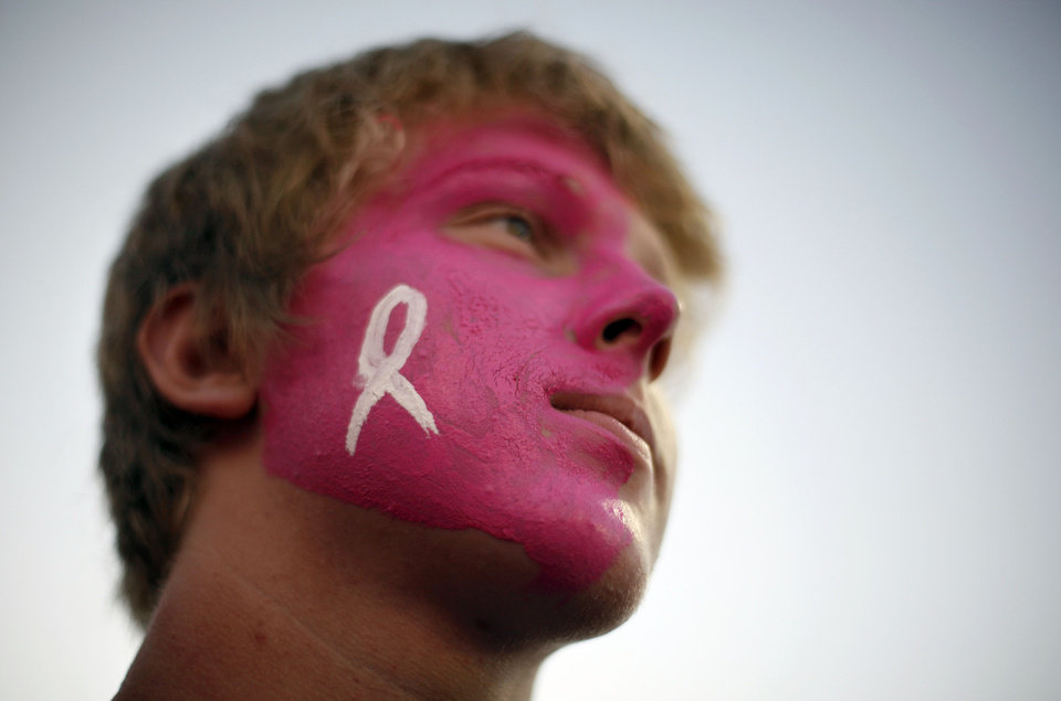 Photo - WIN-WIN WEEK TO RAISE CANCER AWARENESS: With his face painted pink for Win-Win week, Deer Creek student Trent Hau watches the Antlers during the high school football game between Deer Creek and Tecumseh Friday, Sept. 17, 2010, in Oklahoma City. Photo by Sarah Phipps, The Oklahoman