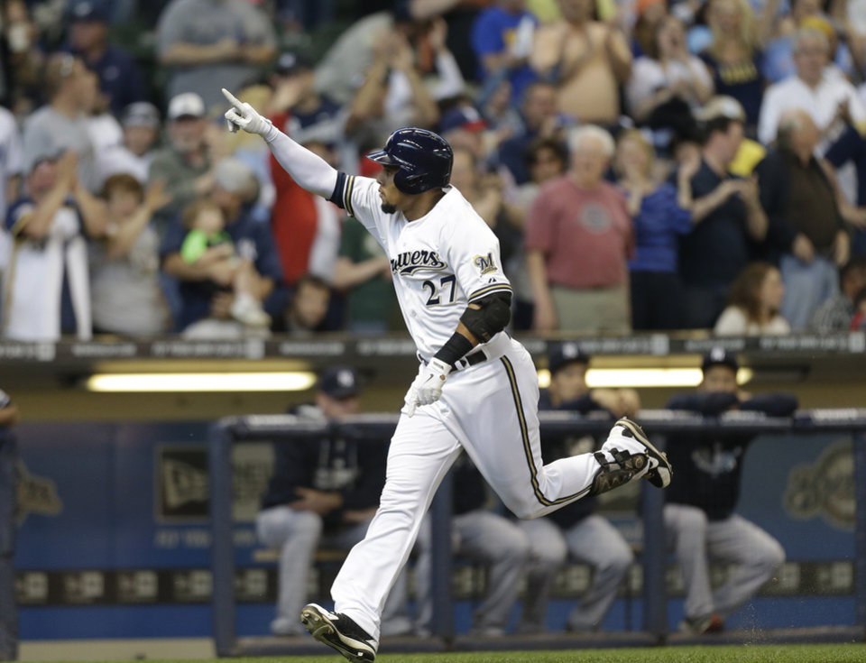 Photo - Milwaukee Brewers' Carlos Gomez reacts after his home run against the New York Yankees in the first inning of a baseball game Saturday, May 10, 2014, in Milwaukee. (AP Photo/Jeffrey Phelps)