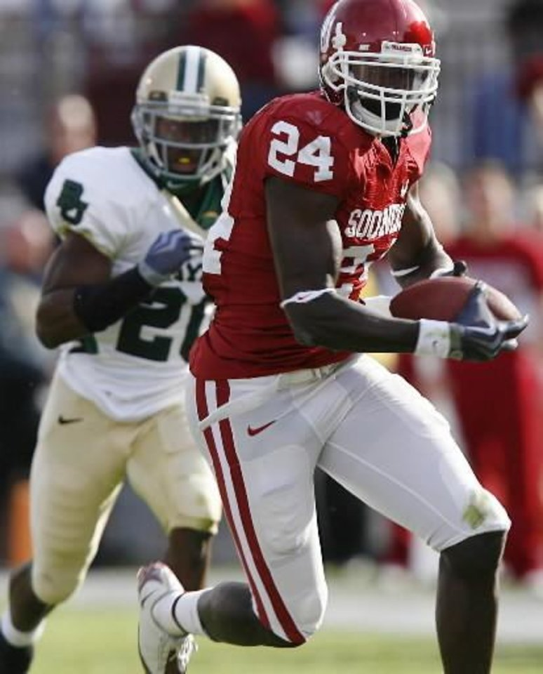 Oklahoma's  Dejuan  Miller (24) takes the ball up field after a reception in over Baylor's Clifton Odom (20) during the second half of the college football game between the University of Oklahoma Sooners (OU) and the Baylor University Bears at Gaylord Family-Oklahoma Memorial Stadium on Saturday, Oct. 10, 2009, in Norman, Okla. Photo by Chris Landsberger
