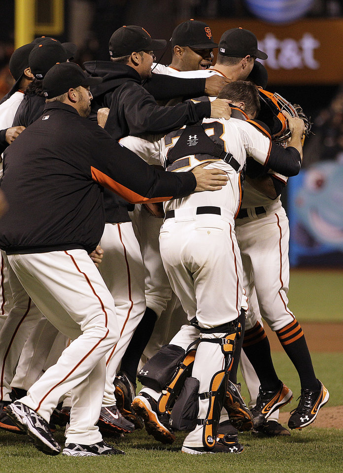 Photo -   San Francisco Giants celebrate after defeating the San Diego Padres to win the National League West Division title after a baseball game Saturday, Sept 22, 2012, in San Francisco. (AP Photo/Ben Margot)