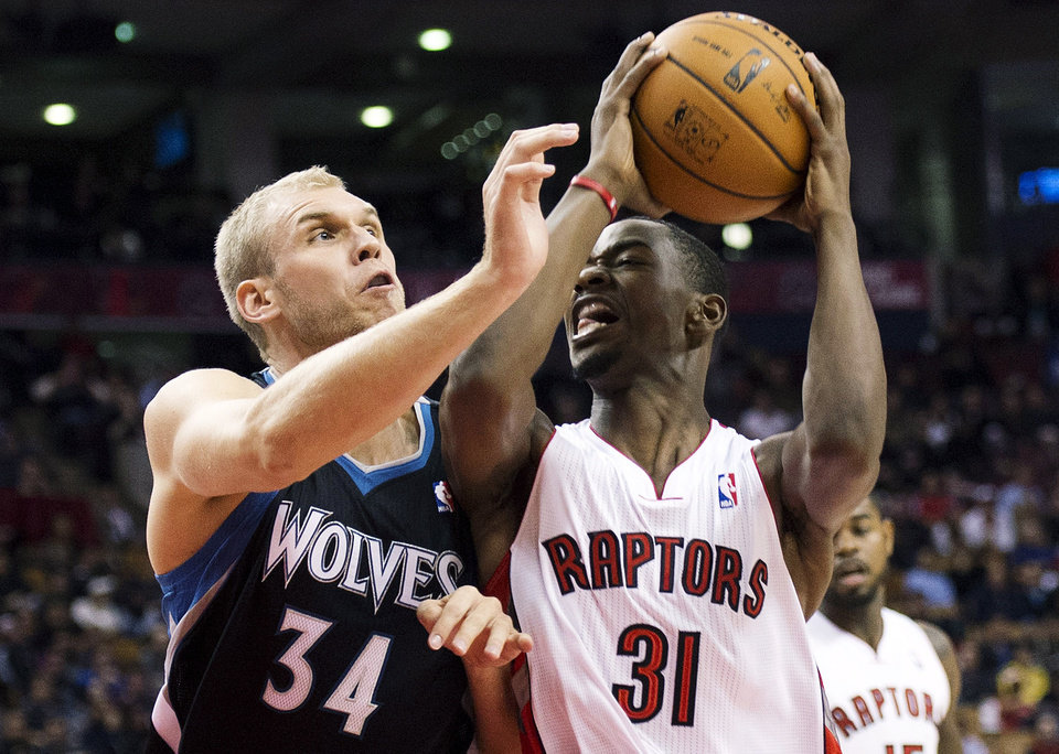 Toronto Raptors forward Terrence Ross (31) battles for the ball against Minnesota Timberwolves center Greg Stiemsma (34) during the first half of their NBA basketball game, Sunday, Nov. 4, 2012, in Toronto. (AP Photo/The Canadian Press, Nathan Denette)