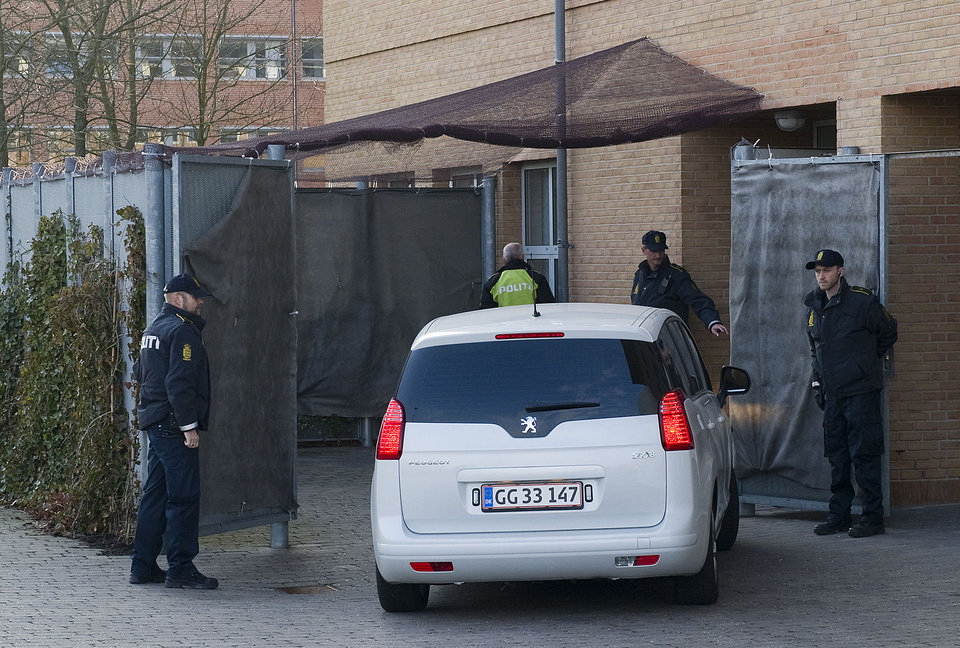 Photo -   A car carrying one of the four defendants enters a secure area outside the court in Copenhagen, Denmark, Friday April 13, 2012, prior to the start of a court case against four men accused of terrorism and illegal possession of weaponry. The terror trial of four Swedes accused of plotting a revenge attack on Danish newspaper Jyllands-Posten that printed caricatures of the Prophet Muhammad, started Friday in Denmark, with a heavily armed police presence. (AP PHOTO/POLFOTO, Kenneth Meyer) DENMARK OUT