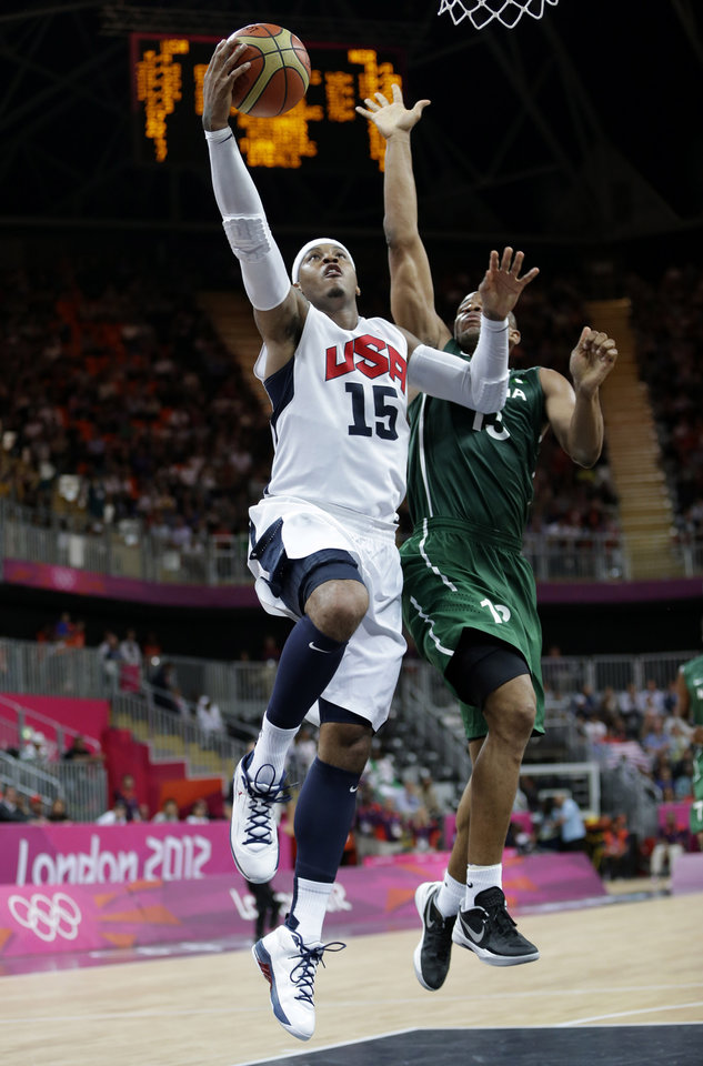Photo -   USA's Carmelo Anthony (15) drives to the basket past Nigeria's Derrick Obasohan (13) during a preliminary men's basketball game at the 2012 Summer Olympics, Thursday, Aug. 2, 2012, in London. (AP Photo/Eric Gay)