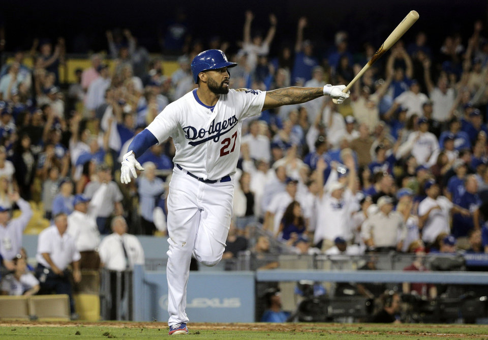 Photo - Los Angeles Dodgers' Matt Kemp watches the flight of his second two-run home run during the seventh inning of a baseball game against the Atlanta Braves on Tuesday, July 29, 2014, in Los Angeles. (AP Photo/Jae C. Hong)