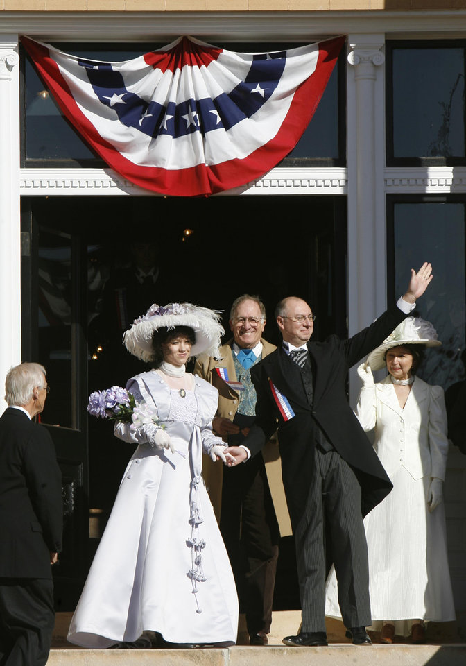 Photo - Miss Indian Territory, Ashlee Choudin, is wed to Mr. Oklahoma Territory, Jay Hanna, in a re-enactment of a statehood ceremony on the steps of the Carnegie Library during the Centennial Day celebrations in Guthrie, OK, Thursday, Nov. 16, 2007. By Paul Hellstern / The Oklahoman