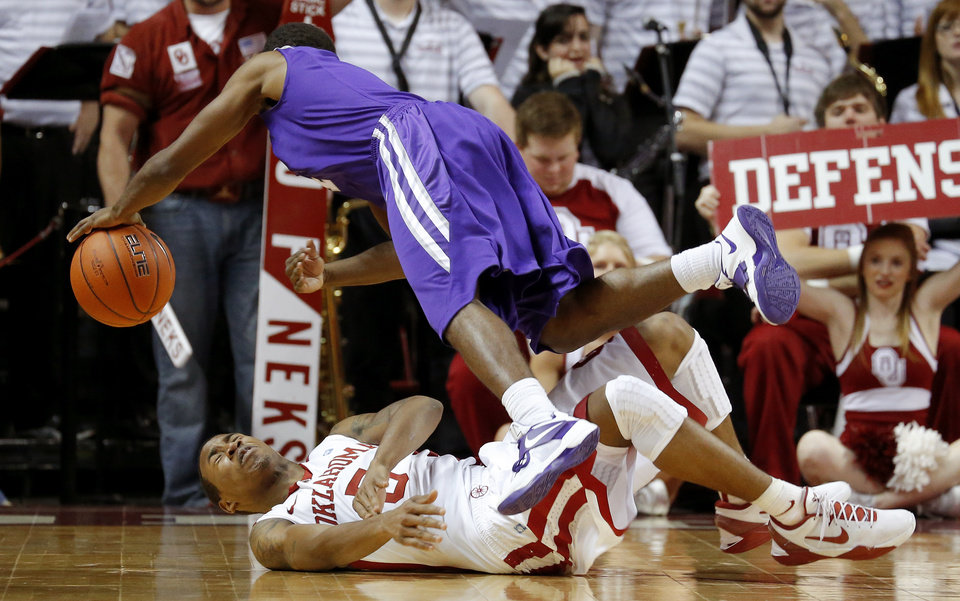 Oklahoma's Je'lon Hornbeak (5) runs into Stephen F. Austin's Hal Bateman (4) during a college basketball game between the University of Oklahoma (OU) and Stephen F. Austin University at the Lloyd Noble Center in Norman, Okla., Tuesday, Dec. 18, 2012. Oklahoma lost 56-55. Photo by Bryan Terry, The Oklahoman