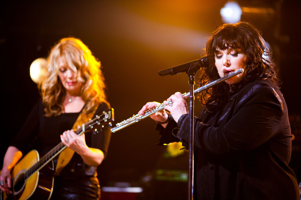 "FILE - In this Oct. 2, 2012 publicity file photo provided by iHeartRadio, Nancy Wilson, left, and Ann Wilson of Heart perform songs from their new album ""Fanatic"" at the iHeartRadio Theater presented by P.C. Richard & Son in New York. Heart is nominated for induction into the Rock and Roll Hall of Fame in 2013. (AP Photo/iHeartRadio, Peter Larson, File)"