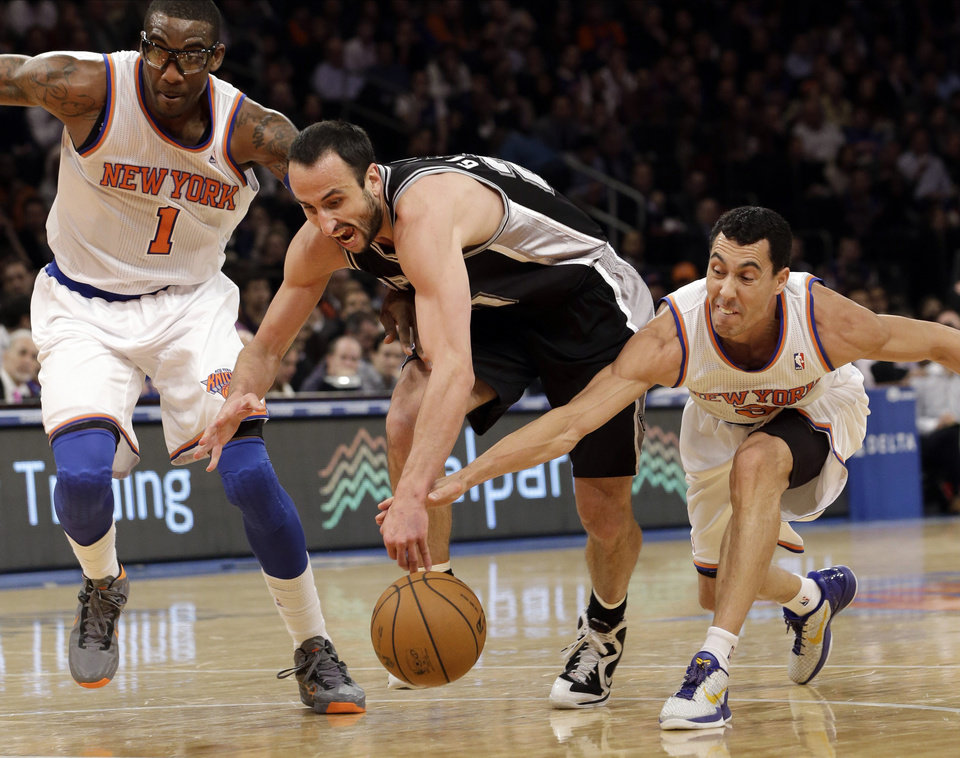 San Antonio Spurs guard Manu Ginobili (20) competes for a loose ball with New York Knicks forward Amare Stoudemire (1) and guard Pablo Prigioni (9) in the first half of their NBA basketball game at Madison Square Garden in New York, Thursday, Jan. 3, 2013. (AP Photo/Kathy Willens)