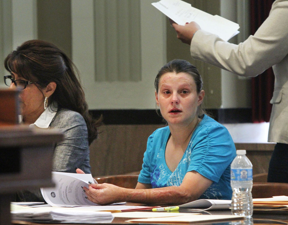An Oklahoma County District Judge sentenced Stephanie Dunham, right, to prison for 18 years for her part in the deaths of her three children. They died in a mobile home fire in Del City in January, 2011. Judge Jerry Bass imposed the penalty on Dunham in his courtroom Wednesday afternoon, July 11, 2012. At left is Dunham\'s attorney, Joan Lopez. Photo by Jim Beckel, The Oklahoman.
