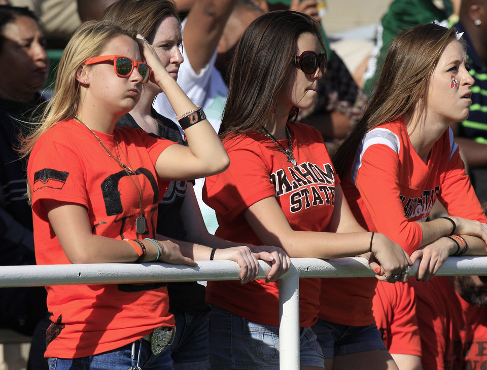 Photo - Oklahoma State fans watch the fourth quarter  of an NCAA college football game against Baylor, Saturday, Dec. 1, 2012, in Waco, Texas. Baylor won 41-34.  (AP Photo/LM Otero) ORG XMIT: TXMO118