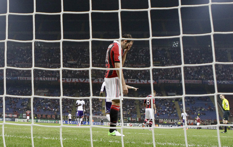 Photo -   AC Milan forward Giampaolo Pazzini reacts after missing a scoring chance during a Champions League, Group C, soccer match between AC Milan and Anderlecht at the San Siro stadium in Milan, Italy, Tuesday, Sept. 18, 2012. (AP Photo/Antonio Calanni)