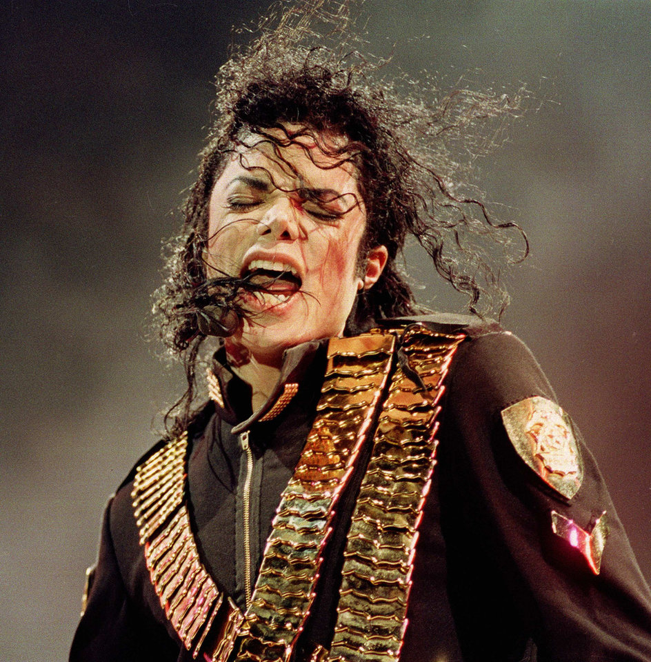 "FILE - In this Aug. 29, 1993 file photo, pop singer Michael Jackson performs during his ""Dangerous"" concert in National Stadium, Singapore.  (AP Photo/C.F. Tham, file) ORG XMIT: NYET712"