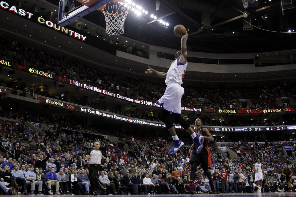 Philadelphia 76ers' Thaddeus Young goes up for a dunk in the second half of an NBA basketball game against the Toronto Raptors, Friday, Jan. 18, 2013, in Philadelphia. Philadelphia won 108-101 in overtime. (AP Photo/Matt Slocum)