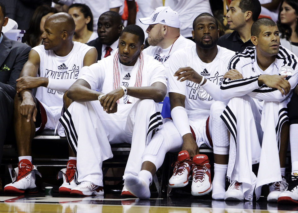 Photo - From left, Miami Heat's Ray Allen, Mario Chalmers, Dwyane Wade and Shane Battier sit on the bench in the second half of Game 2 of their NBA basketball playoff series in the Eastern Conference semifinals against the Chicago Bulls, Wednesday, May 8, 2013, in Miami. The Heat won 115-78. (AP Photo/Lynne Sladky)