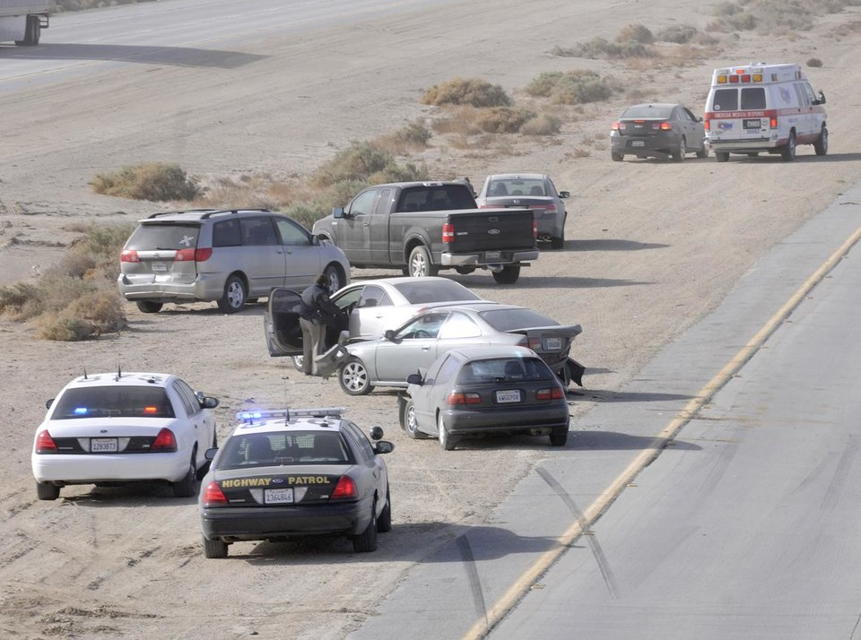 Photo - A chain reaction multiple vehicle collision brings traffic to a stop on the 14 freeway north of Lancaster, Calif., near Avenue B in Los Angeles County, Monday, April 8, 2013. Powerful winds raked much of California on Monday, toppling trees, causing scattered power outages, whipping up blinding dust storms, and sending waves crashing ashore as a vigorous spring weather system swept through the state on its way across the West. (AP Photo/Antelope Valley Press, Ron Siddle)