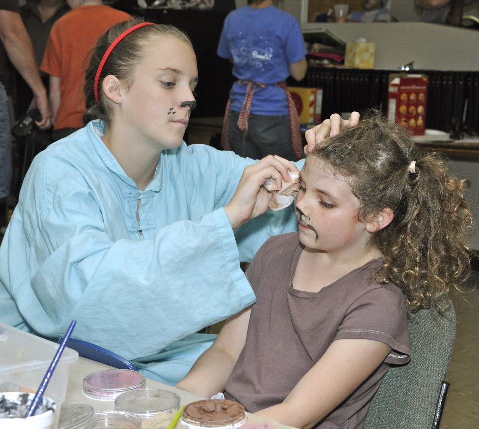 Photo - Courtney Wages helps Ella Pilgrim with her makeup as they get ready for a Saturday performance of
