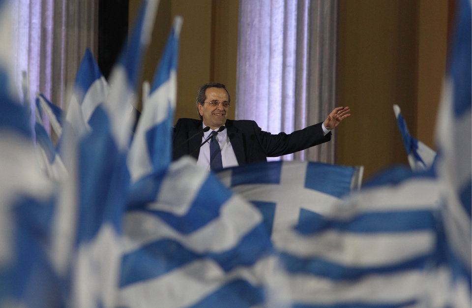 Photo -   Greece's conservative leader of New Democracy party, Antonis Samaras waves to his party members at the Zappeio conference hall in Athens, Thursday, May 3, 2012. Samaras who joined the majority Socialists in a coalition for the past six months, is leading in opinion polls but is facing a strong challenge from rightist splinter parties and a fascist party that have campaigned heavily on illegal immigration in the crisis-hit country. (AP Photo/Thanassis Stavrakis)