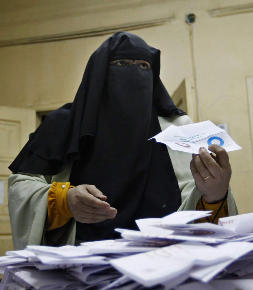 An Egyptian referendum official counts votes at a polling station in Cairo, Egypt, late Saturday, Dec. 15, 2012. Egyptians took their quarrel over a draft constitution to polling stations Saturday after weeks of violent turmoil between the newly empowered Islamists and the mostly liberal opposition over the future identity of the nation. (AP Photo/Amr Nabil)