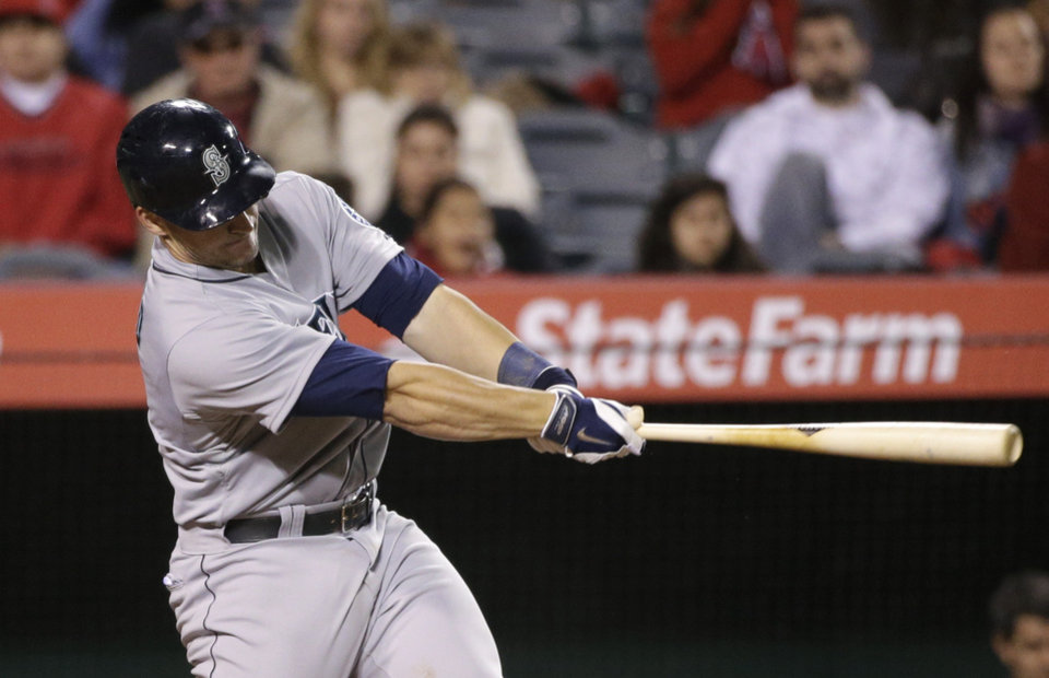 Photo - Seattle Mariners' Mike Zunino swings on a three-run home run during the sixth inning of a baseball game against the Los Angeles Angels on Wednesday, April 2, 2014, in Anaheim, Calif. (AP Photo/Jae C. Hong)