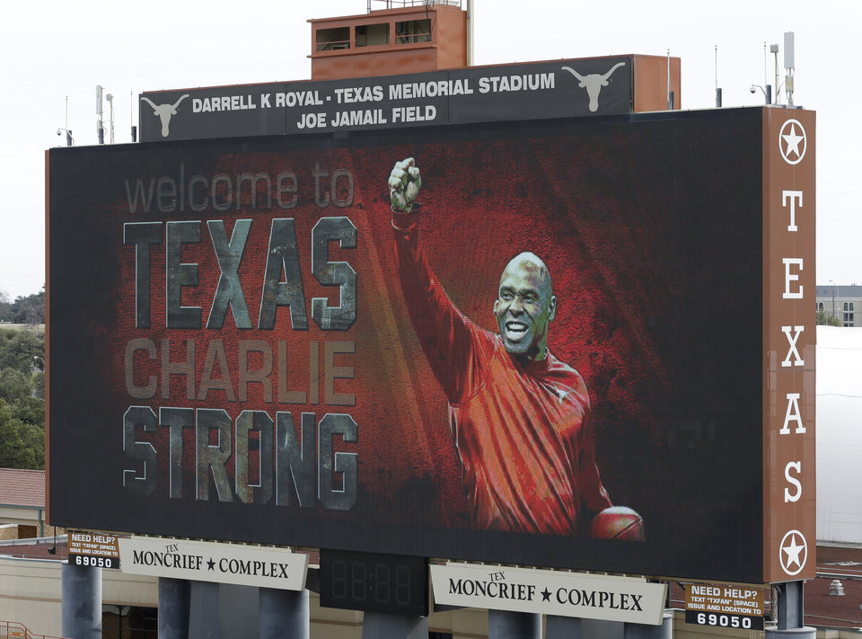 Photo - ADVANCE FOR WEEKEND EDITIONS, AUG. 15-17 - FILE - In this Jan. 6, 2014 file photo, a welcome sign is displayed on the scoreboard at Darrell K Royal–Texas Memorial Stadium for new Texas NCAA college football coach Charlie Strong in Austin, Texas. (AP Photo/Eric Gay, File)