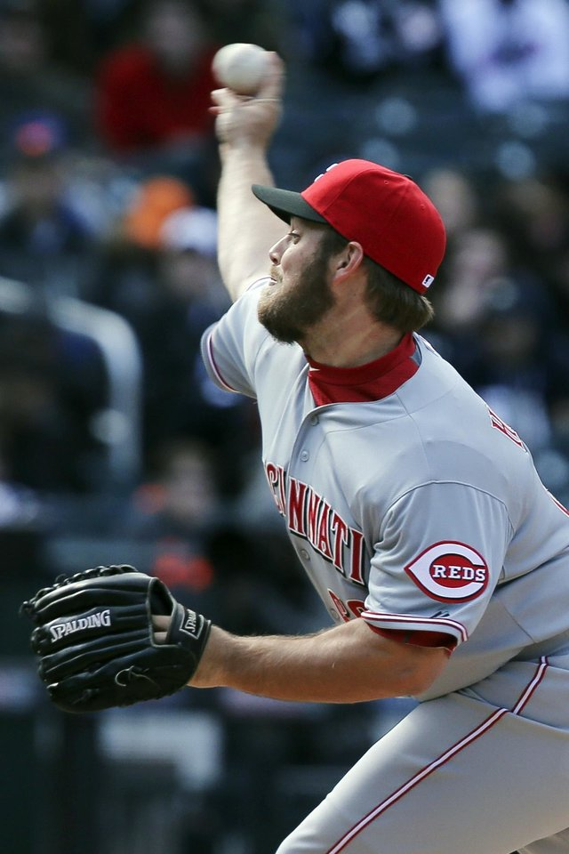 Photo - Cincinnati Reds relief pitcher J.J. Hoover throws in the ninth inning of a baseball game against the New York Mets at Citi Field, Saturday, April 5, 2014, in New York. Hoover gave up a grand slam to New York Mets first baseman Ike Davis in the ninth inning to give the Mets the win, 6-3. (AP Photo/John Minchillo)