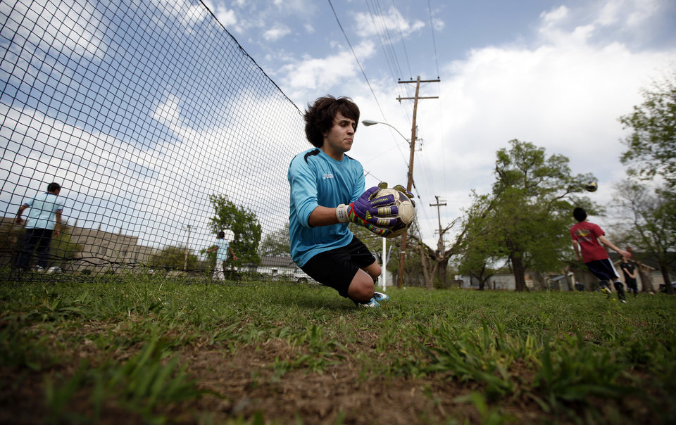 Mauricio Limon  practices in front of a temporary goal during soccer practice at an abandoned lot near Dove Science Academy in Oklahoma City, Tuesday, March 27, 2012. Photo by Sarah Phipps The Oklahoman