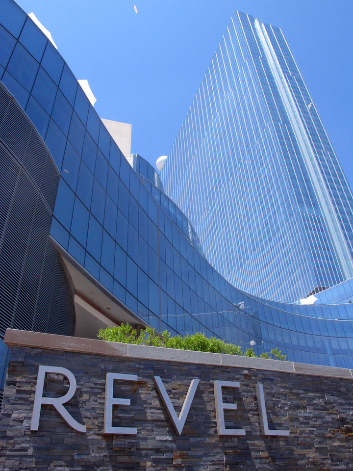 Photo - FILE - This May 30, 2014 file photo shows the exterior of Revel Casino Hotel in Atlantic City N.J. The Revel Casino Hotel will shut down on Sept. 10, 2014 after failing to find a buyer in bankruptcy court, company officials announced Tuesday, Aug. 12, 2014.  (AP Photo/Wayne Parry, File)