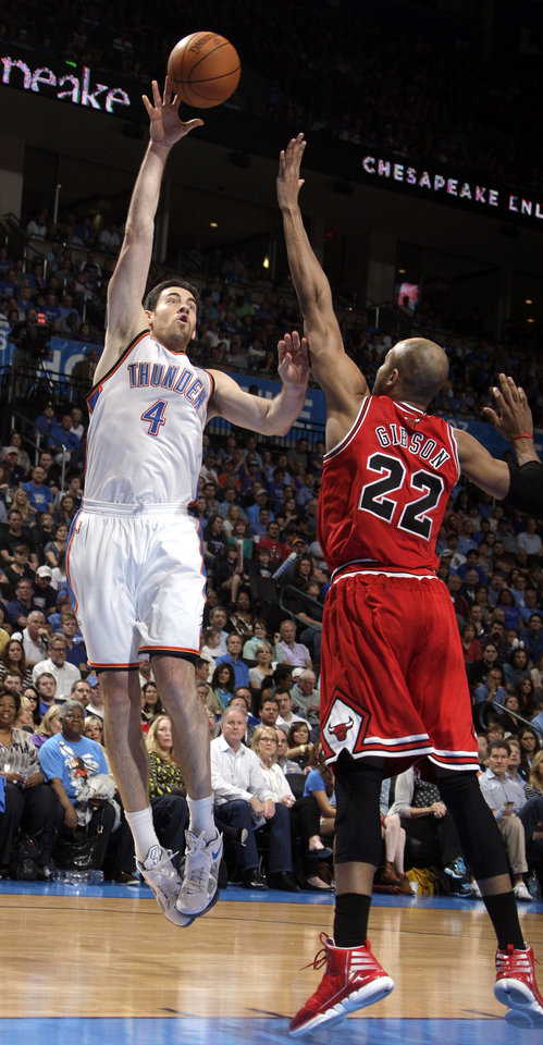 Oklahoma City's Nick Collison (4) shoots over Chicago's Taj Gibson (22) during the NBA basketball game between the Chicago Bulls and the Oklahoma City Thunder at Chesapeake Energy Arena in Oklahoma City, Sunday, April 1, 2012. Photo by Sarah Phipps, The Oklahoman