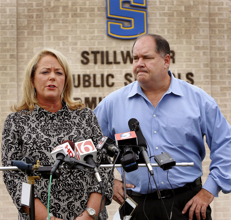 Photo - Ann Caine, Stillwater Public Schools superintendent, and Capt. Randy Dickerson with the Stillwater Police Department answer media questions about the death of Stillwter Junior High School eighth grade student Cade Poulos, 13, who died this morning from a self-inflicted gunshot wound at the school.  Photo by Jim Beckel, The Oklahoman.
