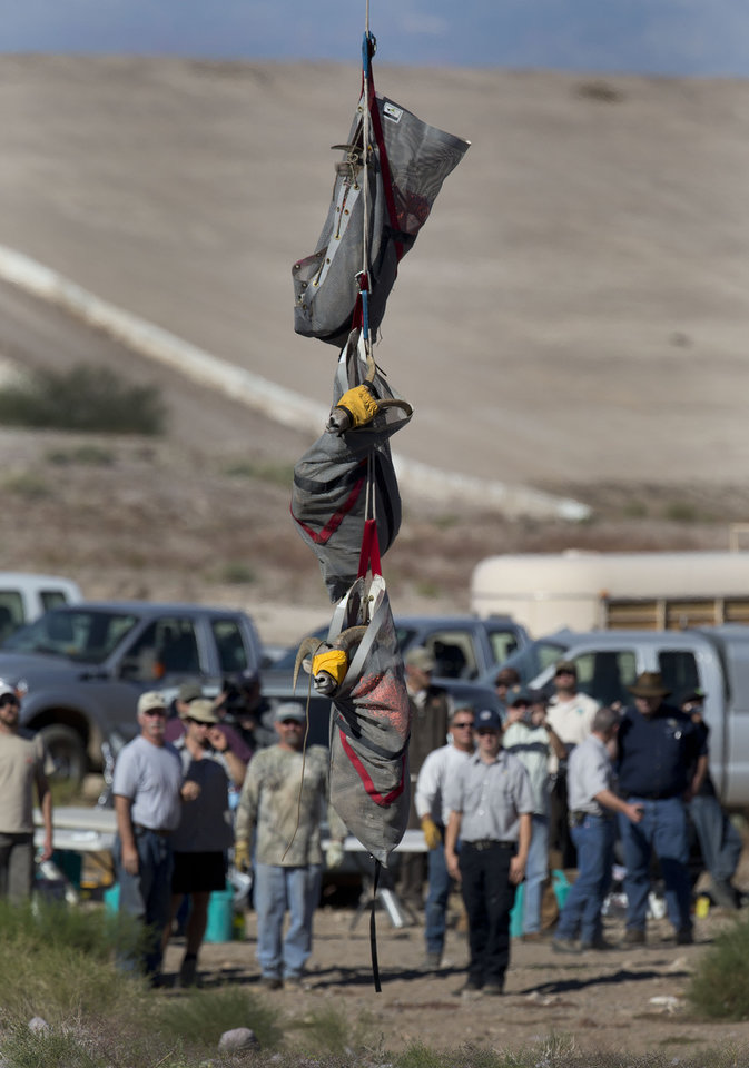 In this Wednesday, Oct. 31, 2012 photo, captured big horn sheep are lowered to the ground from a helicopter, near Henderson, Nev. In an attempt to help repopulate areas of southern Utah, fifty sheep from the River and Muddy mountains in southern Nevada are being captured for relocation to Grand Staircase National Monument. (AP Photo/Julie Jacobson)