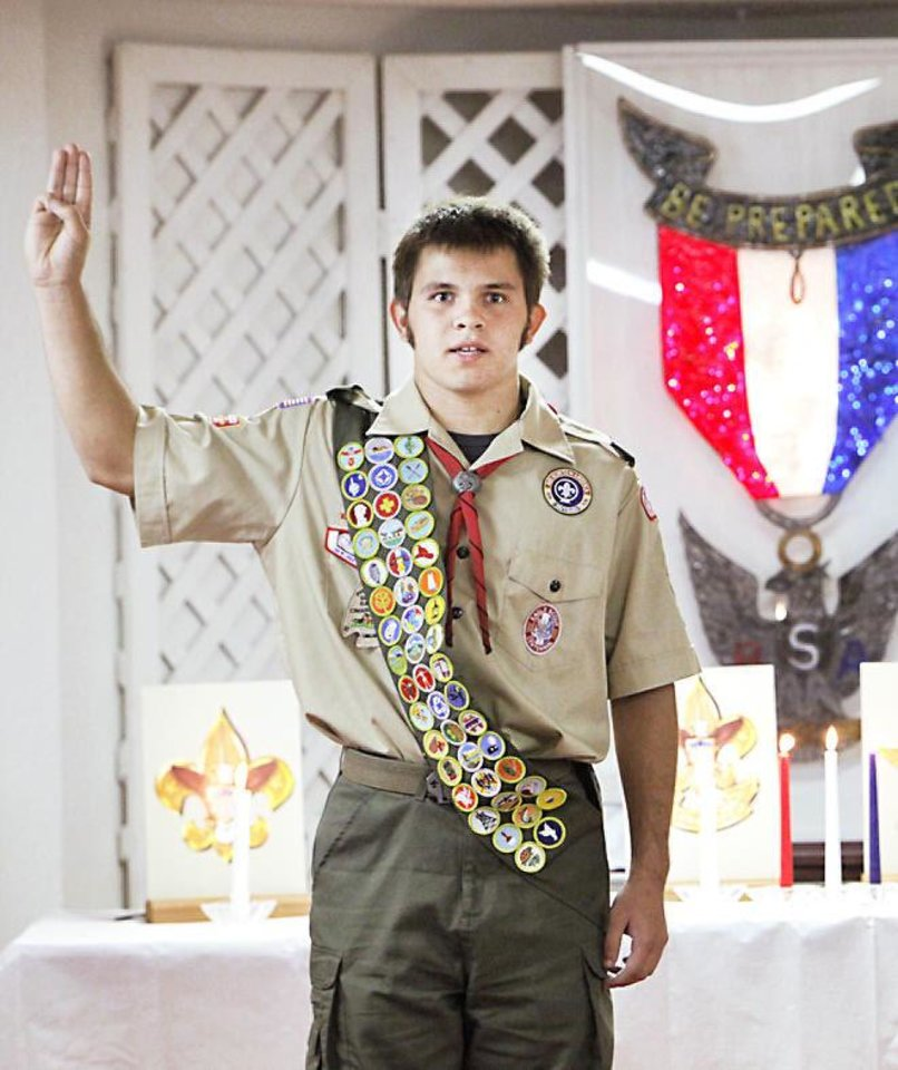 Photo - Caleb Browning takes the Eagle oath at his Eagle ceremony in September.  Photo by David McDaniel, The Oklahoman