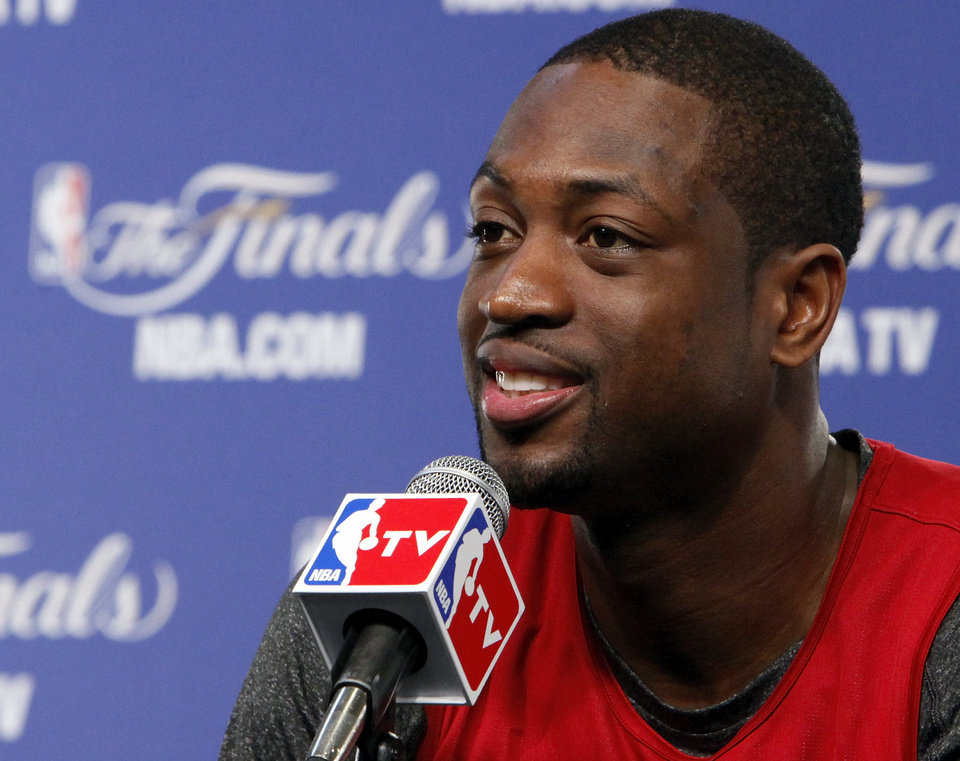 Photo - Miami's Dwyane Wade responds to a question during media and practice day for the NBA Finals between the Oklahoma City Thunder and the Miami Heat at the Chesapeake Energy Arena in Oklahoma City, Monday, June 11, 2012. Photo by Nate Billings, The Oklahoman
