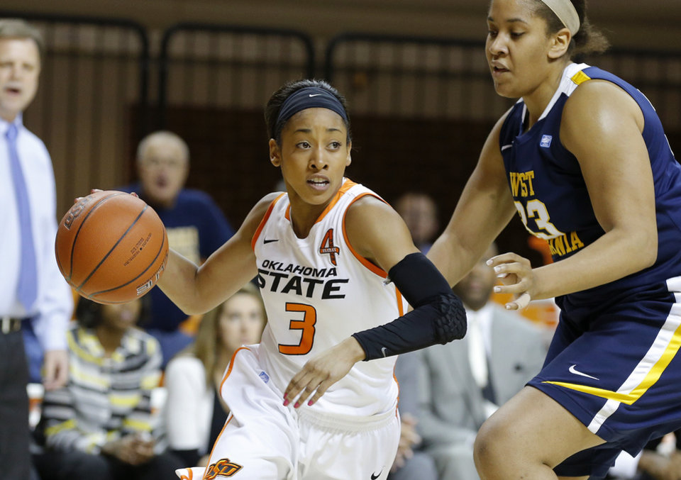 Oklahoma State's Tiffany Bias (3) goes around West Virginia's Ayana Dunning (33) during a women's college basketball game between Oklahoma State and West Virginia at Gallagher-Iba Arena in Stillwater, Okla.,  Tuesday, Jan. 29, 2013. Photo by Bryan Terry, The Oklahoman
