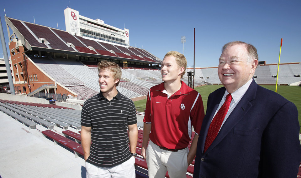 Seniors Matt Deimund and Ryan Fightmaster discuss the upcoming Oklahoma Run to Defeat Diabetes with OU President David Boren in the football stadium, Thursday , August 26, 2010.          Photo by David McDaniel, The Oklahoman