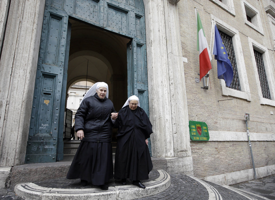 Photo - Nuns leave a polling station after voting in downtown Rome, Sunday, Feb. 24, 2013. Italy votes in a watershed parliamentary election Sunday and Monday that could shape the future of one of Europe's biggest economies. (AP Photo/Andrew Medichini)