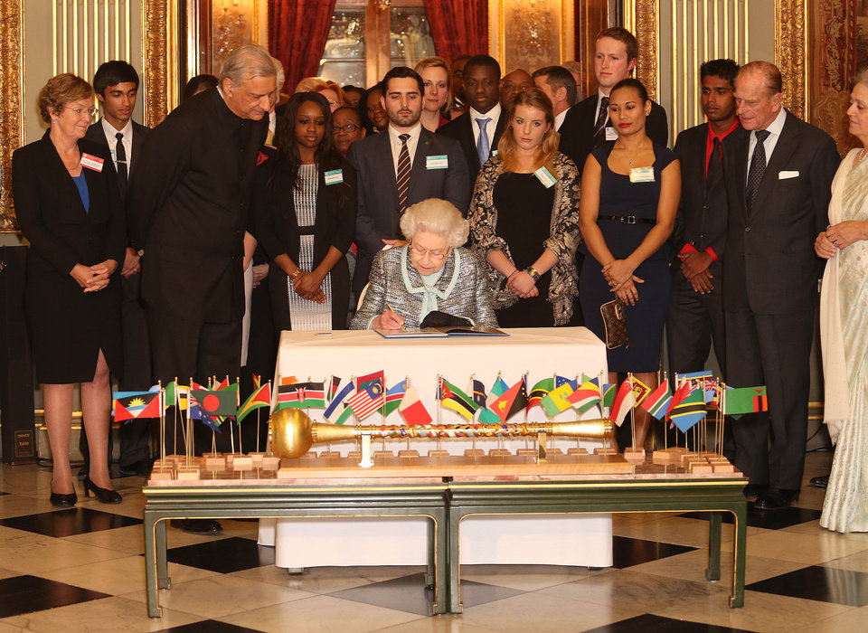 Photo - Britain's Queen Elizabeth II, Head of the Commonwealth signs the Commonwealth Charter at a reception at Marlborough House, London, Monday March 11, 2013. The Charter is an historic document which brings together, for the first time in the associations 64-year history, key declarations on Commonwealth principles. (AP Photo/PA, Philip Toscano)  UNITED KINGDOM OUT  NO SALES  NO ARCHIVE