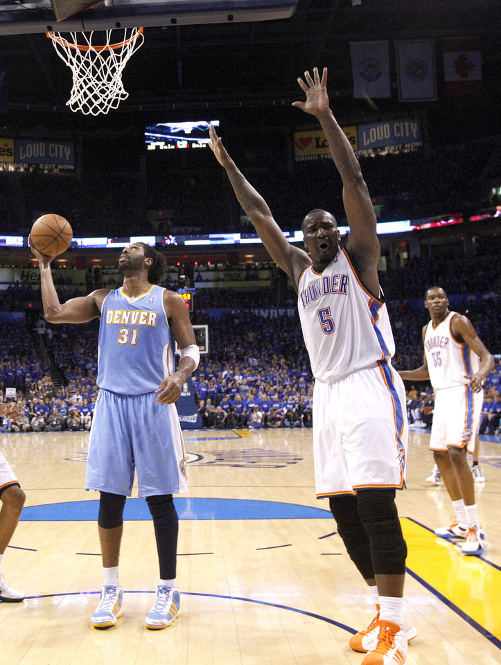 Oklahoma City's Kendrick Perkins (5) reacts after being called for an offensive foul during the first round NBA basketball playoff game between the Oklahoma City Thunder and the Denver Nuggets on Saturday, April 20, 2011, at the Oklahoma City Arena. Photo by Sarah Phipps, The Oklahoman