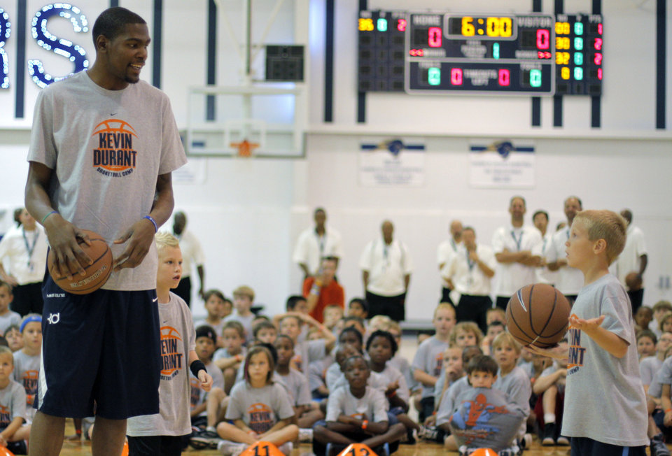 CHILD / CHILDREN / KIDS: Kevin Durant goes head-to-head in a shootout with Jake Cochnauer, 8 of Minnesota, during the second day of the Kevin Durant basketball camp at Heritage Hall in Oklahoma City, Thursday, June 30, 2011. Photo by Garett Fisbeck, The Oklahoman ORG XMIT: KOD