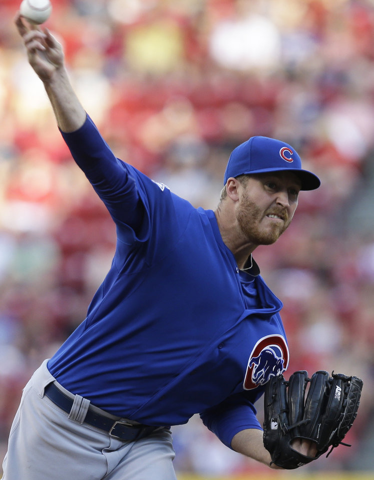 Photo - Chicago Cubs starting pitcher Dallas Beeler throws against the Cincinnati Reds in the first inning of a baseball game, Wednesday, July 9, 2014, in Cincinnati. (AP Photo/Al Behrman)