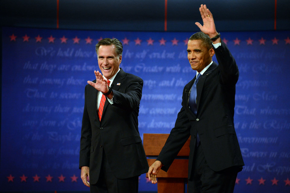 President Barack Obama and former Massachusetts Governor Mitt Romney wave at the start of the presidential debate at the University of Denver Wednesday, Oct. 3, 2012, in Denver. (AP Photo/The Denver Post, John Leyba) MAGS OUT; TV OUT; INTERNET OUT ORG XMIT: CODEN211