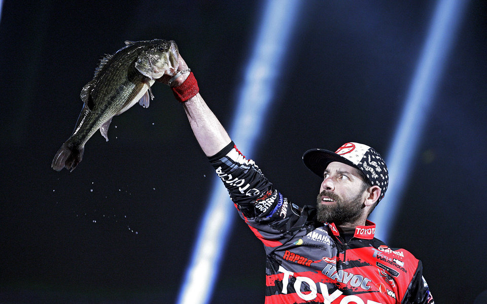 Photo - Michael Iaconelli shows off a fish during  weigh in on the first day of the Bassmaster Classic  Feb. 22, 2013. MIKE SIMONS/Tulsa World