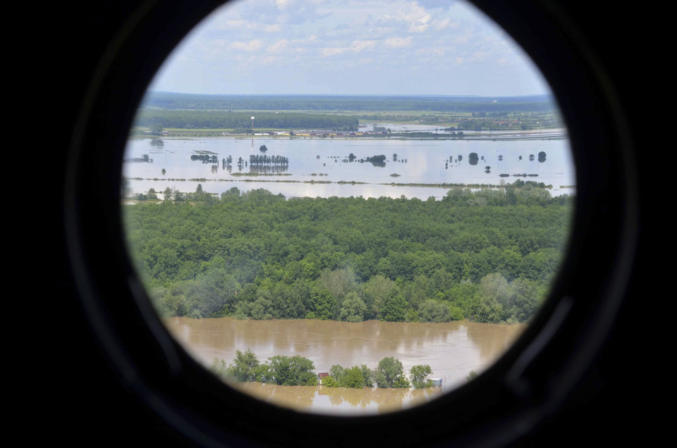 Photo - This image taken on taken Sunday, May 18, 2014 and made available by the Bosnia Army shows an aerial view from a helicopter of the flooded area near the Bosnian town of Brcko along the river Sava, 200 kms north of Bosnian capital of Sarajevo. Three months' worth of rain fell on the Balkan region in three days, producing the worst floods since rainfall measurements began 120 years ago. (AP Photo/Bosnia Army)