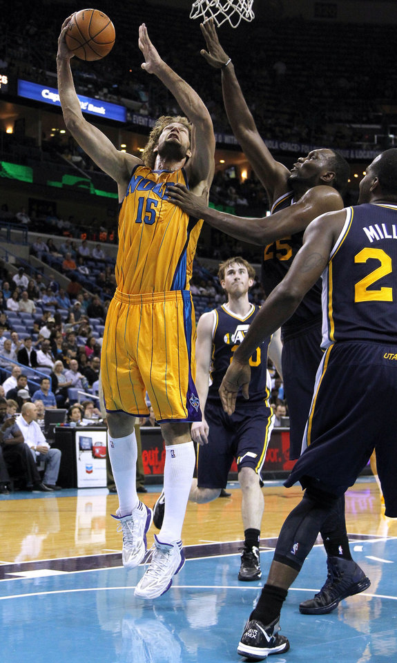 Photo -   New Orleans Hornets center Robin Lopez (15) shoots over Utah Jazz center Al Jefferson (25) during the second half of an NBA basketball game in New Orleans, Friday, Nov. 2, 2012. The Hornets won 88-86. (AP Photo/Jonathan Bachman)