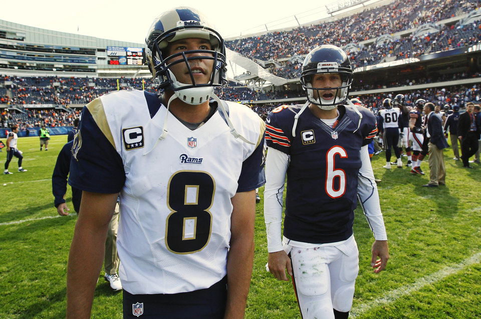 Photo -   Chicago Bears quarterback Jay Cutler (6) and St. Louis Rams quarterback Sam Bradford (8) leave the field after the Bears' 23-6 win over the Rams in an NFL football game in Chicago, Sunday, Sept. 23, 2012. (AP Photo/Charles Rex Arbogast)