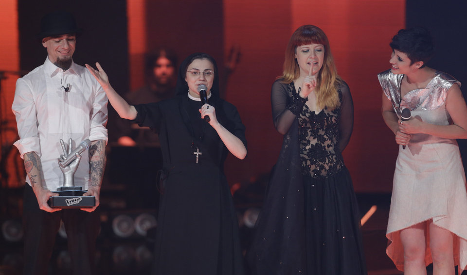 Photo - Sister Cristina Scuccia, second from left, recites the prayer 'Our Father'  on the stage after winning the final of the Italian version of the TV talent show