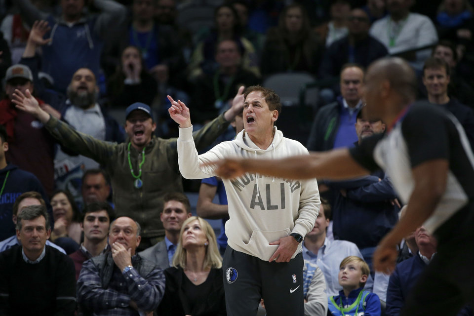 Photo - Dallas Mavericks owner Mark Cuban argues a call as they played the Utah Jazz during the second half an NBA basketball game in Dallas, Monday, Feb. 10, 2020. Utah defeated Dallas 123-119. (AP Photo/Michael Ainsworth)